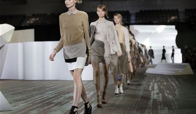 Models walk in the finale of the spring 2011 collection of Phillip Lim during Fashion Week in New York, Wednesday, Sept. 15, 2010. (AP Photo/Richard Drew)
