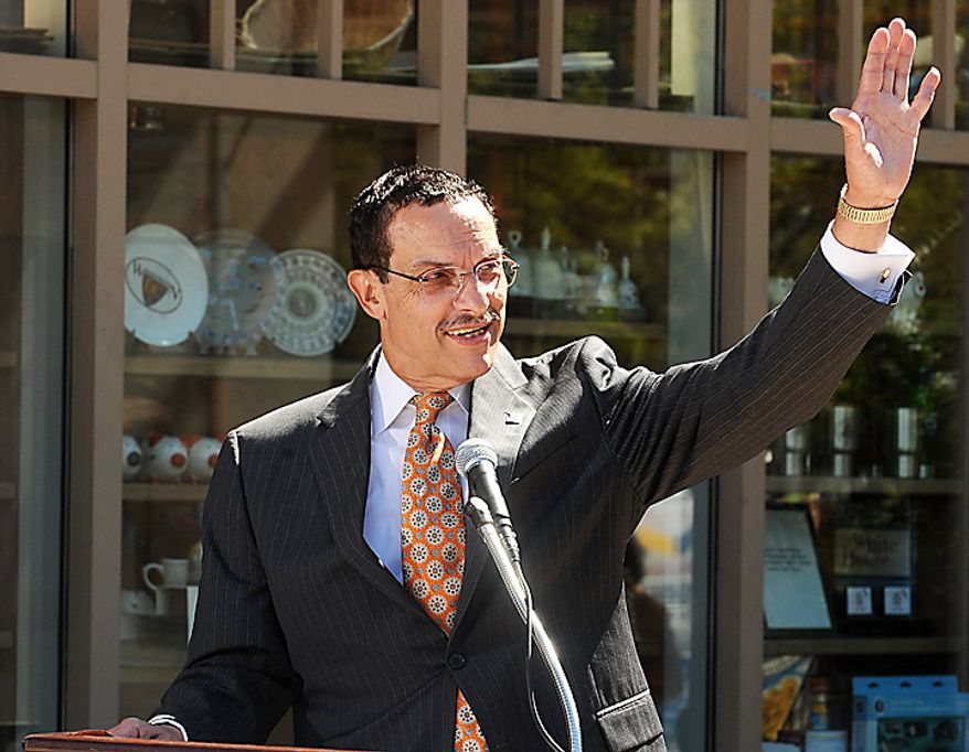 DC Council Chairman Vince Gray waves as he speaks to the media and supporters after defeating incumbent Adrian Fenty in the primary for mayor in Washington on September 15, 2010. (UPI/Roger L. Wollenberg)