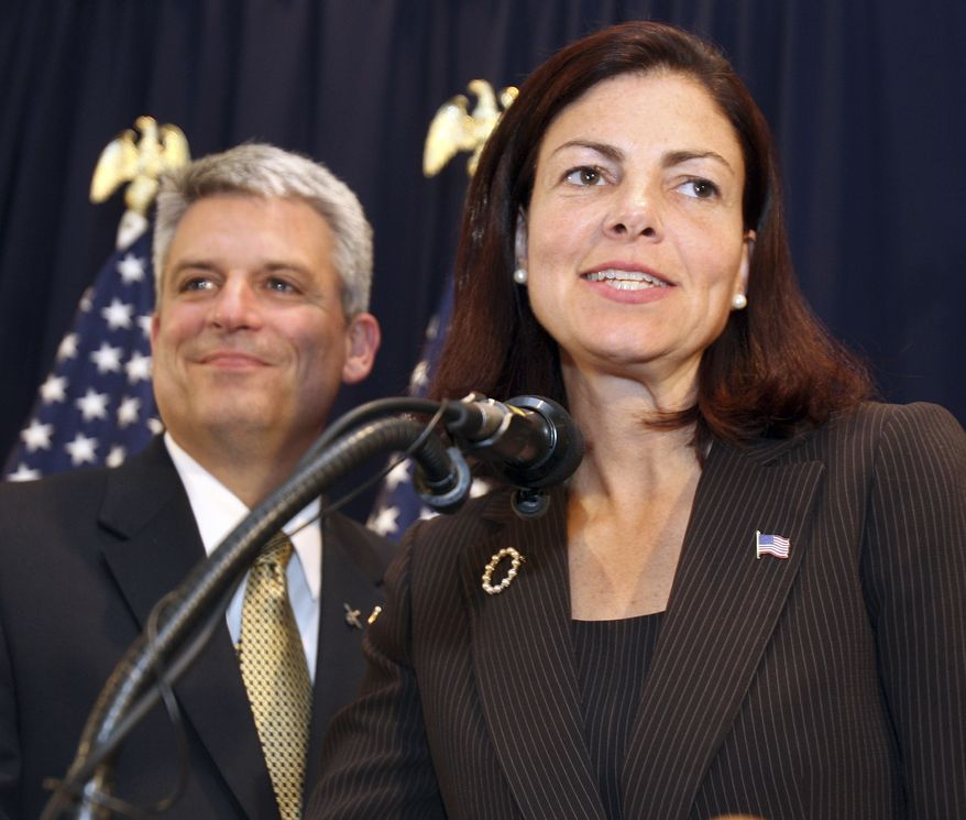 Republican U.S. Senate hopeful Kelly Ayotte talks to supporters with her husband Joe Daley at her side in Concord, N.H., Tuesday, Sept. 14,2010. (AP Photo/Jim Cole)