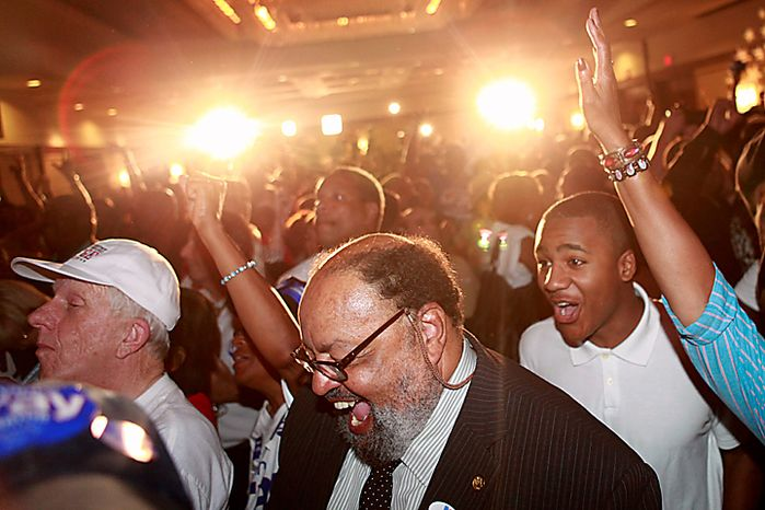 Supporters of District of Columbia mayoral candidate and Council Chairman Vincent Gray react as numbers begin to come in for his race against Mayor Adrian Fenty at Gray's primary party in Washington, on Tuesday Sept. 14, 2010. (AP Photo/Jacquelyn Martin)