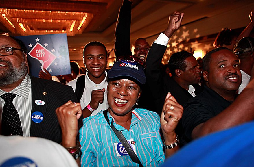 Supporters of District of Columbia mayoral candidate and Council Chairman Vincent Gray react as numbers begin to come in for his race against Mayor Adrian Fenty at Gray's primary party in Washington, on Tuesday, Sept. 14, 2010. (AP Photo/Jacquelyn Martin)
