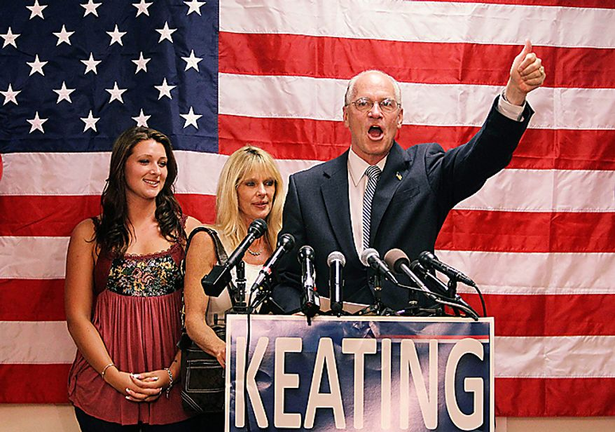 Democratic congressional candidate for the Massachusetts 10th District William Keating addresses supporters during his primary night victory campaign rally in Quincy, Tuesday, Sept. 14, 2010. Keating's wife Tevis, center, and daughter Kristen, left, look on. (AP Photo/Stephan Savoia)