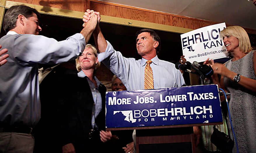 Former Maryland Republican Gov. Bob Ehrlich is congratulated by a supporter as he claims the Republican nomination during a victory party at the Ropewalk Tavern Baltimore, Tuesday, Sept. 14, 2010. Ehrlich won the nomination for a rematch against the man who ousted him from office in 2006, Democratic Gov. Martin O'Malley. Flanking Ehrlich are his wife Kendal Ehrlich, right, and his running mate Mary Kane. (AP Photo/Carolyn Kaster)