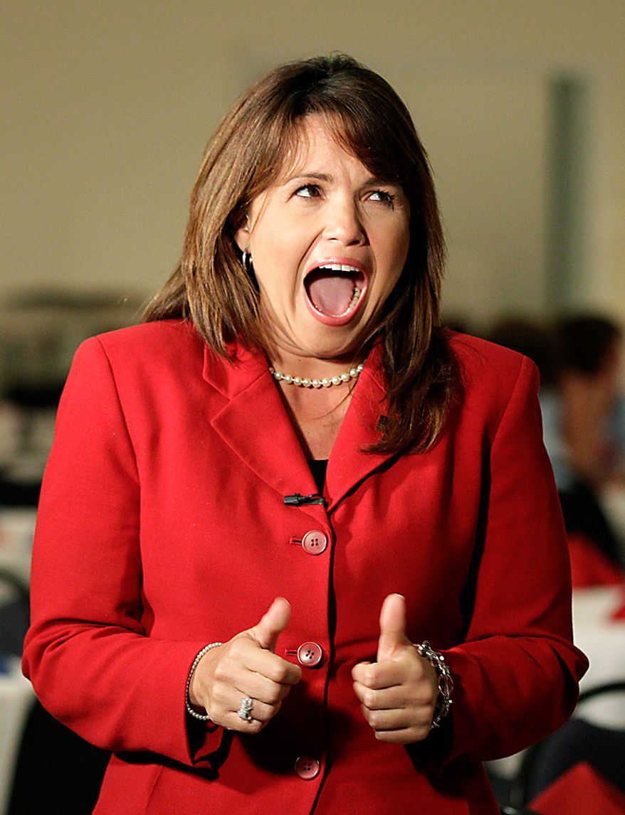 Republican Senate candidate Christine O'Donnell jokes with a supporter while waiting to be interviewed at her election-night party on Tuesday, Sept. 14, 2010, in Dover, Del. (AP Photo/Rob Carr)