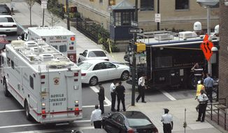 Command units set up at Monument and Wolfe streets outside Johns Hopkins Hospital in Baltimore after a gunman shot a doctor and then barricaded himself inside a room on Thursday, Sept. 16, 2010. The doctor was rushed to surgery and is expected to survive, police spokesman Anthony Guglielmi said. (AP Photo/News Journal, Jon P. Zaimes)