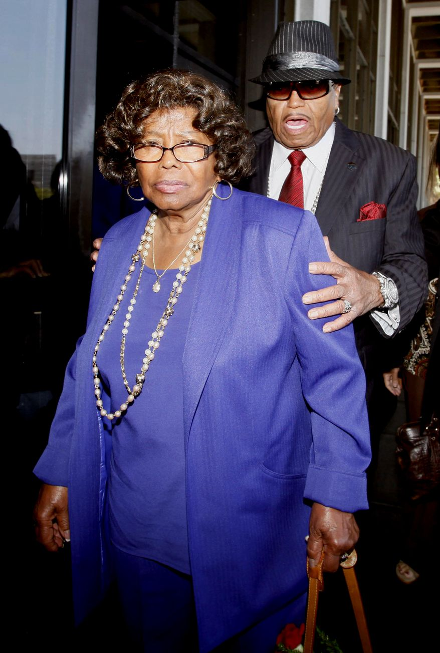 In this June 14, 2010, photo, Michael Jackson's parents, Katherine Jackson and Joe Jackson leave a Los Angeles courthouse after a preliminary hearing setting and motions in the trial of Michael Jackson's personal doctor Conrad Murray. Katherine Jackson has sued the promoter of what were intended to be the pop star's comeback concerts for fraud and other claims related to the singer's death on Wednesday, Sept. 15, 2010. (AP Photo/Nick Ut)