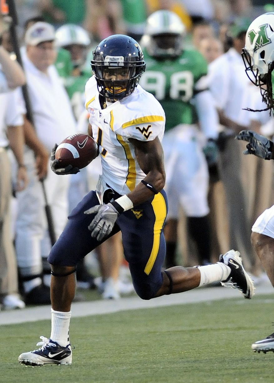 ASSOCIATED PRESS This photo made Sept. 10, 2010, shows West Virginia's Tavon Austin running with the ball against Marshall during an NCAA college football game in Huntington, W.Va. The Maryland native will have fans rooting for him from both states on Saturday when No. 21 West Virginia (2-0) and the Terrapins (2-0) renew their longtime rivalry.