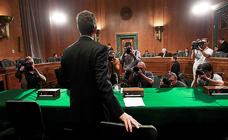 Treasury Secretary Timothy Geithner takes his seat on Capitol Hill in Washington, Thursday, Sept. 16, 2010, prior to testifying before the Senate Banking Committee hearing on the Treasury Department's report on international economic and exchange rate policies.   (AP Photo/Manuel Balce Ceneta)