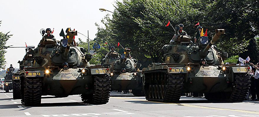South Korean Marines' heavy armored vehicles parade on a street to celebrate of the 60th Incheon Landing Operations Commemoration, Wednesday, Sept. 15, 2010 near Incheon, the South Korean coastal city where United Nations Forces led by U.S. Gen. Douglas MacArthur landed in September 1950 just months after North Korea invaded the South. (AP Photo/ Lee Jin-man)