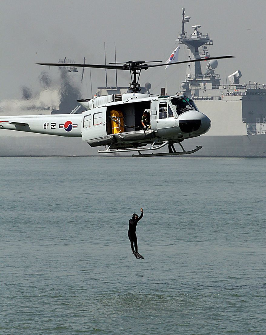 A South Korean Marine jumps into the sea during the 60th Incheon Landing Operations Commemoration Ceremony, Wednesday, Sept. 15, 2010 at sea near Incheon, the coastal city where United Nations Forces led by U.S. General Douglas MacArthur landed in September, 1950 just months after North Korea invaded the South. (AP Photo/ Lee Jin-man)