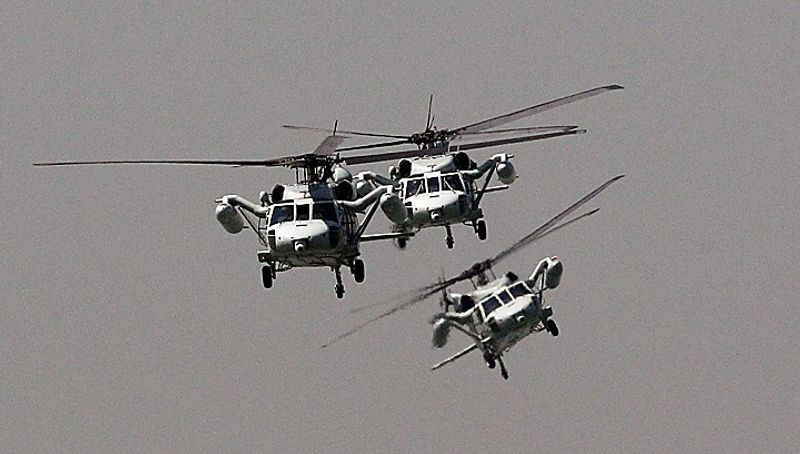 South Korean Navy helicopters fly during the 60th Incheon Landing Operations Commemoration Ceremony, Wednesday, Sept. 15, 2010 at sea near Incheon, the coastal city where United Nations Forces led by U.S. General Douglas MacArthur landed in September, 1950 just months after North Korea invaded the South. (AP Photo/ Lee Jin-man)