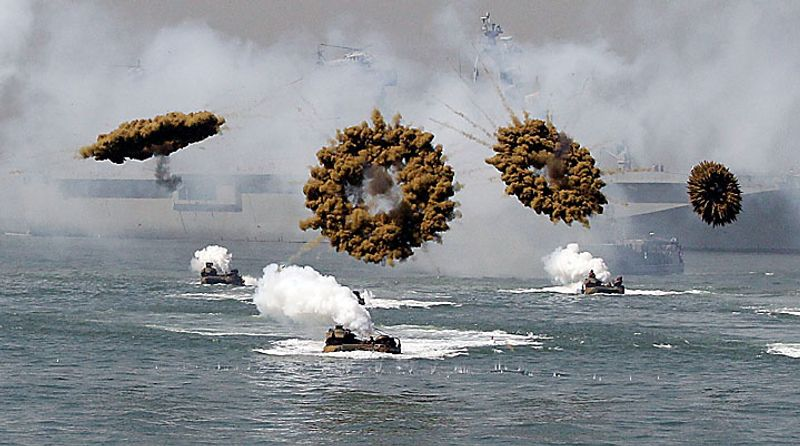 U.S. and the South Korean Marine landing crafts sail to shores in a smoke screen during the 60th Incheon Landing Operations Commemoration Ceremony, Wednesday, Sept. 15, 2010 at sea near Incheon, the coastal city where United Nations Forces led by U.S. General Douglas MacArthur landed in September, 1950 just months after North Korea invaded the South. (AP Photo/ Lee Jin-man)