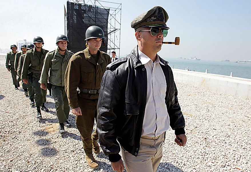 U.S. Marine, right, playing the role of U.S. General Douglas MacArthur and other Marines playing the role of U.S. and South Korean Generals, participate during the 60th Incheon Landing Operations Commemoration Ceremony, Wednesday, Sept. 15, 2010 at sea near Incheon, the coastal city where United Nations Forces led by U.S. General Douglas MacArthur landed in September, 1950 just months after North Korea invaded the South. (AP Photo/ Lee Jin-man)