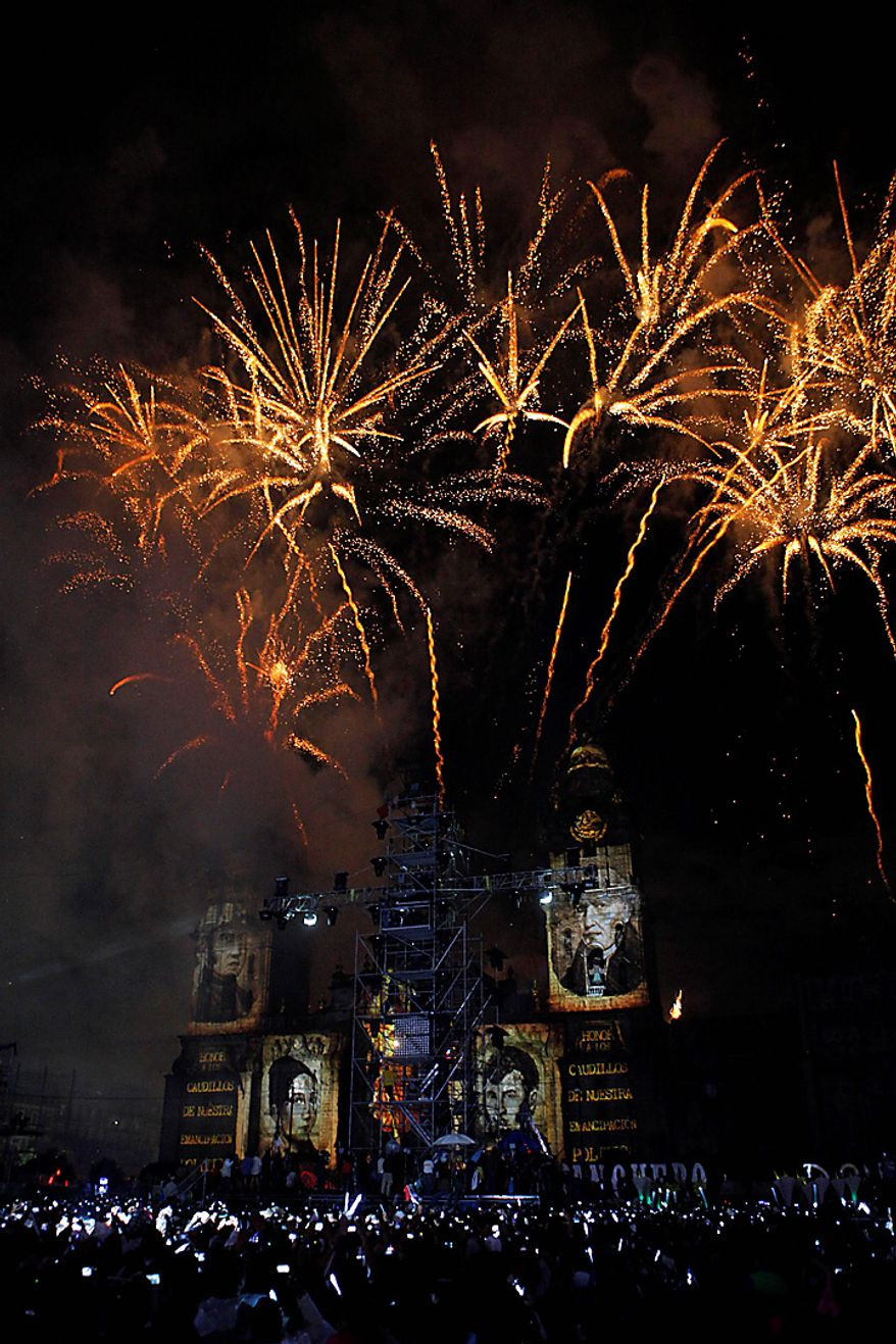 Fireworks explode over the Metropolitan Cathedral during bicentennial celebrations at the Zocalo in Mexico City, Wednesday Sept. 15, 2010.  Mexico celebrates the 200th anniversary of its 1810 independence uprising.(AP Photo/Alexandre Meneghini)