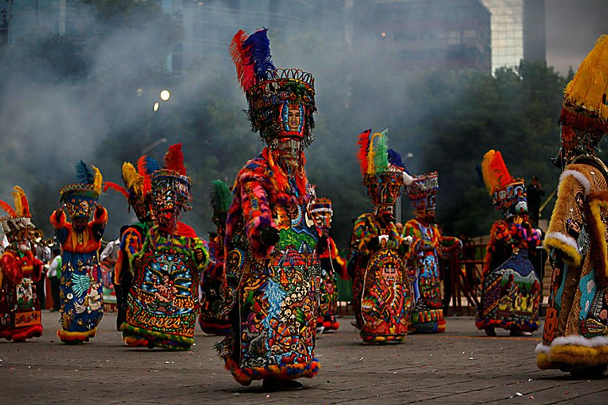 Chinelo dancers perform during the bicentennial parade in Mexico City, Wednesday Sept. 15, 2010. Mexico celebrates the 200th anniversary of its 1810 independence uprising. (AP Photo/Miguel Tovar)