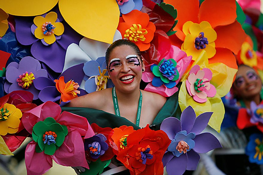 A dancer dressed as a bouquet of flowers performs during the bicentennial parade in Mexico City, Wednesday Sept. 15, 2010.  Mexico celebrates the 200th anniversary of its 1810 independence uprising. (AP Photo/Miguel Tovar)