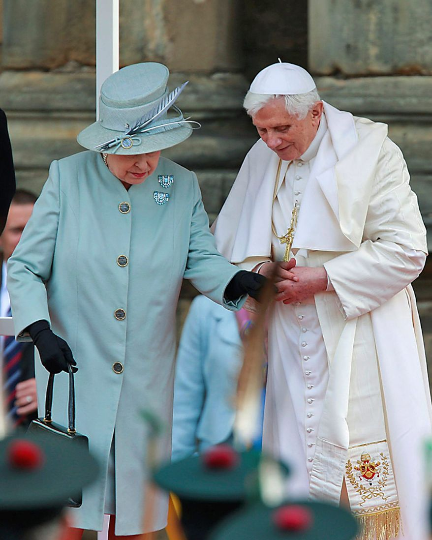 Pope Benedict XVI, right, and Britain's Queen Elizabeth II leave after inspecting an honor guard of members of the Royal Company of Archers and members of the Royal Regiment of Scotland Band as the Pope arrives at the Palace of Holyroodhouse, in Edinburgh, Scotland, Thursday Sept. 16, 2010. (AP Photo/Lefteris Pitarakis, pool)