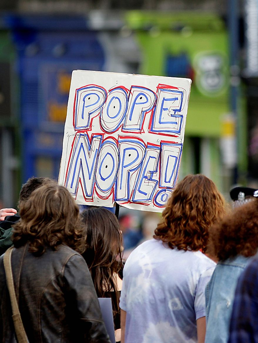 Protestors hold a placard protesting the visit of  Pope Benedict XVI to Edinburgh, Scotland, Thursday Sept. 16, 2010. Pope Benedict XVI arrives in the United Kingdom on Thursday for a four-day visit, a controversial yet historic state trip that has been overshadowed by the sex abuse scandals which have shaken confidence in the Roman Catholic Church. (AP Photo/Jon Super).