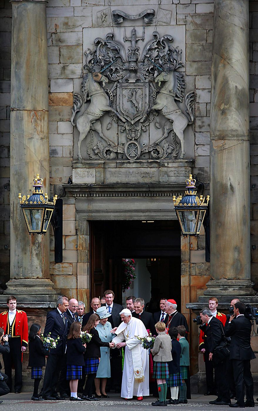 Britain's Queen Elizabeth II, bottom left, accompanies Pope Benedict XVI, right, as he receives flowers from children while leaving the Palace of Holyroodhouse, in Edinburgh, Scotland, Thursday Sept. 16, 2010. (AP Photo/Lefteris Pitarakis, pool)