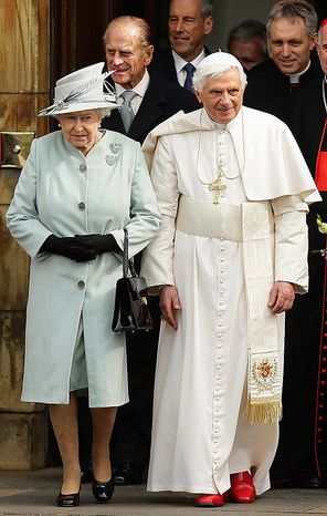 Britain's Queen Elizabeth II, left, walks with Pope Benedict XVI as they leave the Palace of Holyroodhouse in Edinburgh, Scotland,  following his formal welcome on the first day of his four day visit to Britain, Thursday Sept. 16, 2010.  Prince Philip following behind left and Pope's personal secretary Gerog Gaenswein, behind right. (AP Photo / Dave Thompson, pool)