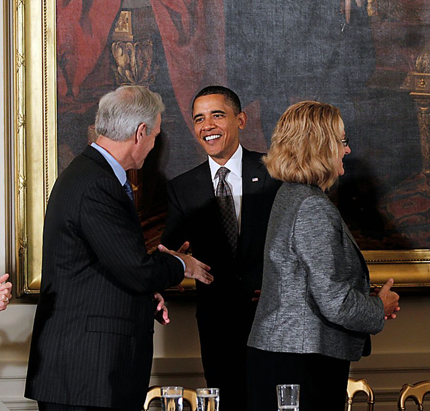 President Barack Obama greets UPS CEO Scott Davis, as he arrives  in the East Room of the White House in Washington, Thursday, Sept. 16, 2010, where the president announced his recommendations on free trade agreements at a meeting of his export council. At right is Vermeer  Corporation President Mary Vermeer Andringa. Less than two months before congressional elections, and with the economy a top issue for voters, Obama is turning his attention to trade, highlighting his goal of doubling U.S. exports over five years to drive economic growth. (AP Photo/J. Scott Applewhite)