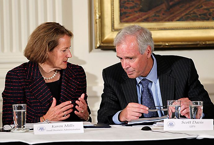 Small Business Administration head Karen Mills, left, and UPS CEO Scott Davis attend a meeting of President Obama's export council, Thursday, Sept. 16, 2010, in the East Room of the White House in Washington. Less than two months before congressional elections, and with the economy a top issue for voters, Obama is turning his attention to trade, highlighting his goal of doubling U.S. exports over five years to drive economic growth. (AP Photo/J. Scott Applewhite)