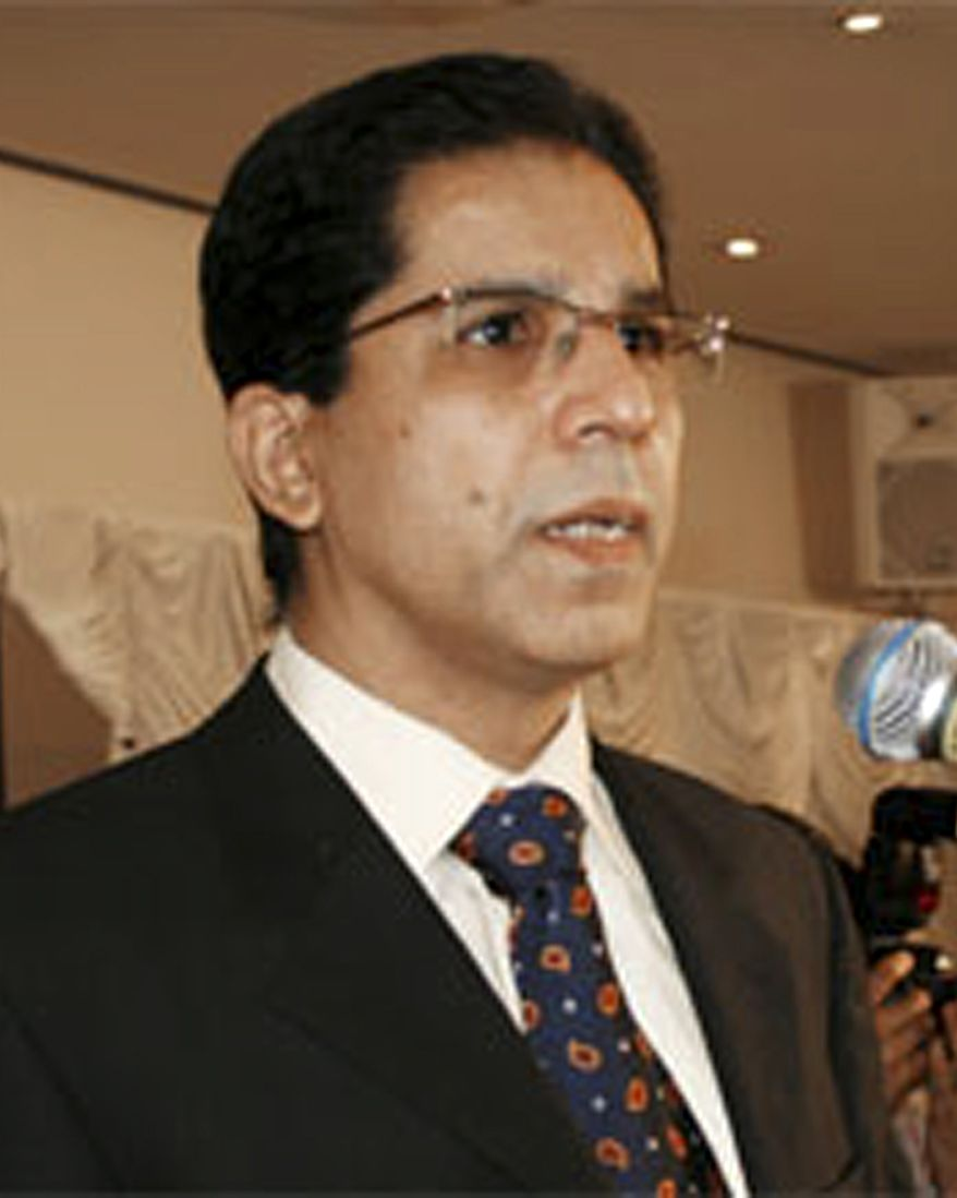 In this undated photo released by Muttahida Qaumi Movement's senior politician Imran Farooq speaks in London. Gangs torched vehicles and a shop in Pakistan's largest city of Karachi on Friday, Sept. 17, 2010, after Mr. Farooq was stabbed to death in London. Farooq's body was found in north London Thursday with multiple stab wounds and head wounds. (AP Photo/Muttahida Qaumi Movement)