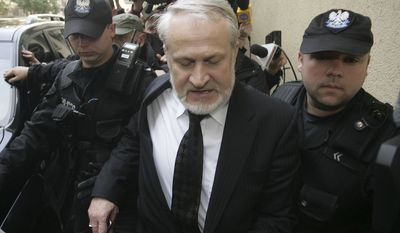 Polish police officers arrest the head of the Chechen government in exile Akhmed Zakhayev who is wanted in Russia on terrorism, charges, in Warsaw, Poland, Friday, Sept.17, 2010. Mr. Zakhayev, who resides in London, came to Poland to attend a World Congress of Chechens. (AP Photo/str)