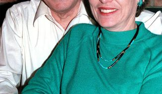In this 1998 photo, Leo Mascheroni and his wife Marjorie pose in their Los Alamos, N.M. home. A scientist and his wife who both once worked at Los Alamos National Laboratory were arrested Friday, Sept. 17, 2010 after an FBI sting operation and charged with conspiring to help develop a nuclear weapon for Venezuela. (AP Photo/The Santa Fe New Mexican, Clyde Mueller)
