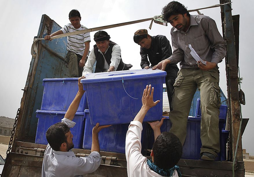 Afghans unload ballot materials from a truck outside a polling station on the eve of the parliamentary election in Kabul, Afghanistan, Friday, Sept. 17, May. 2010. Afghanistan will go to parliamentary election as the Taliban have warned of countrywide attacks on Saturday targeting voters and election workers. (AP Photo/Musadeq Sadeq)