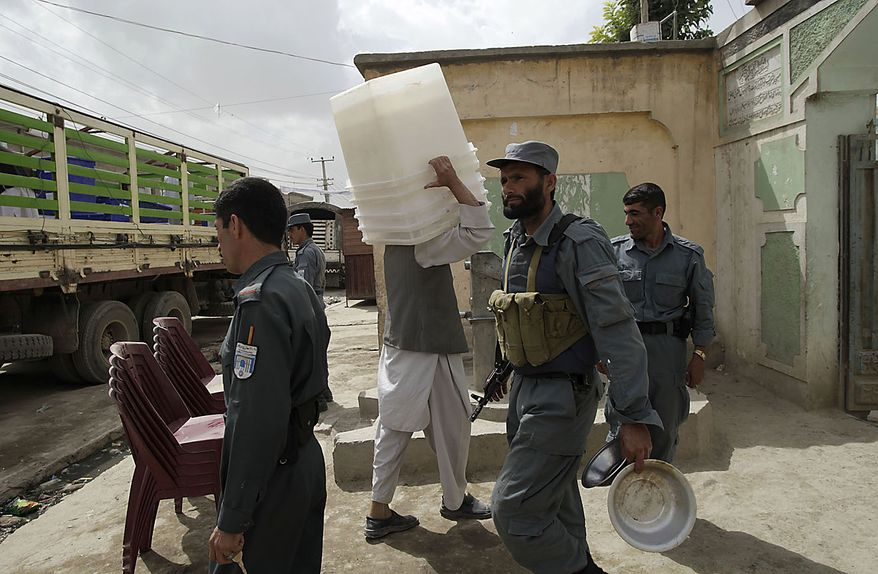 A poll worker carries ballot boxes to a mosque tat will serve as a polling station in Kabul, Afghanistan, Friday, Sept. 17, 2010. Afghanistan will elect the lower house of its parliament on Saturday. (AP Photo/Saurabh Das)