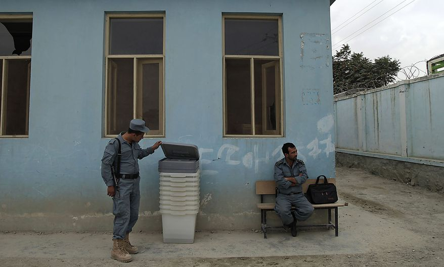A police officer checks out a ballot box after they are delivered at a polling station in Kabul, Afghanistan, Friday, Sept. 17, 2010. Afghanistan will elect the lower house of its parliament on Saturday. (AP Photo/Saurabh Das)