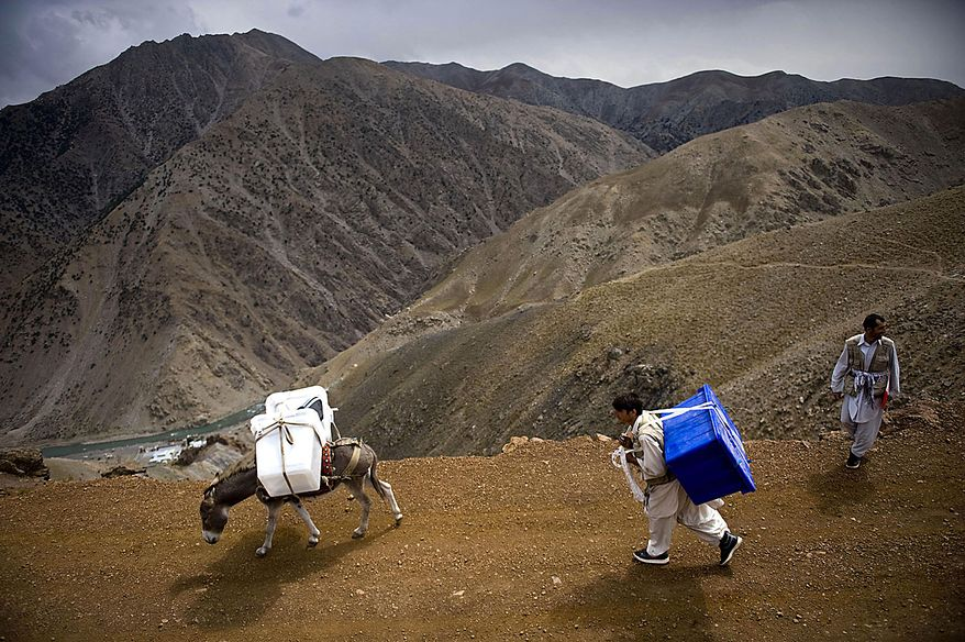 A donkey is used to transport ballot materials to a polling station in Panjshir valley in Afghanistan, Friday, Sept. 17, 2010. Afghanistan will elect the lower house of its parliament on Saturday. (AP Photo/Hossein Fatemi)