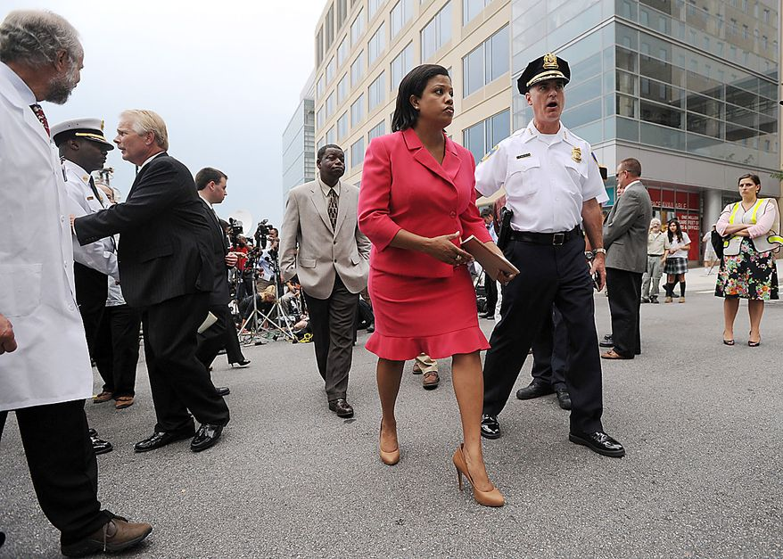 Baltimore Police Commissioner Fred Bealefeld, front right, talks to Baltimore Mayor Stephanie Rawlings-Blake after a news conference near Johns Hopkins hospital Thursday, Sept. 16, 2010 in Baltimore. According to Baltimore police, a man named Paul Warren Pardus, 50, shot and injured a doctor and later shot and killed his own mother, Jean Davis, and himself inside the hospital Thursday. (AP Photo/Steve Ruark)