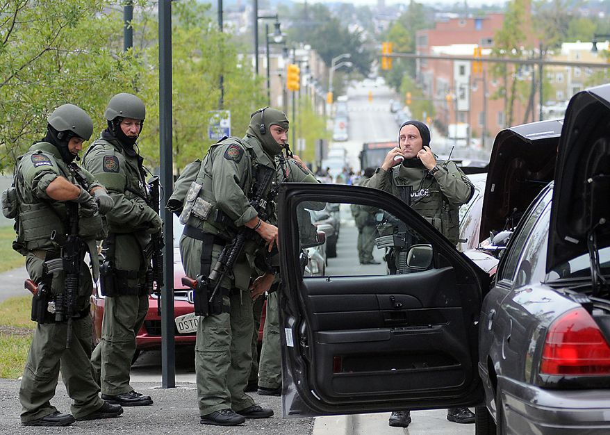 Members of the Baltimore County SWAT team arrive at Johns Hopkins Hospital in Baltimore after a man shot and wounded a doctor, Thursday, Sept. 16, 2010. (AP Photo/Steve Ruark)