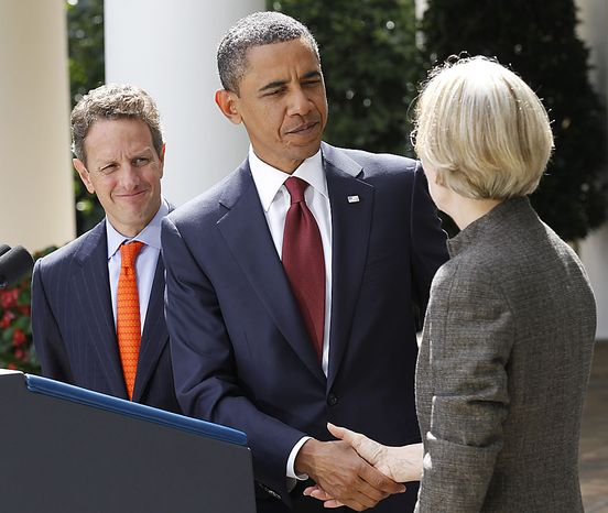 President Barack Obama shakes hands with Elizabeth Warren, right, as Secretary of Treasury Timothy Geithner left,  looks on after announcing that Warren will head the Consumer Financial Protection Bureau, Friday, Sept. 17, 2010, during an event in the Rose Garden of the White House in Washington. (AP Photo/Pablo Martinez Monsivais)