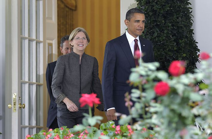 President Barack Obama, followed by Elizabeth Warren, center, and Treasury Secretary Timothy Geithner, walks of the Oval Office, to the Rose Garden of the White House in Washington, Friday, Sept. 17, 2010, where he announced that Warren will head the Consumer Financial Protection Bureau.  (AP Photo/Susan Walsh)
