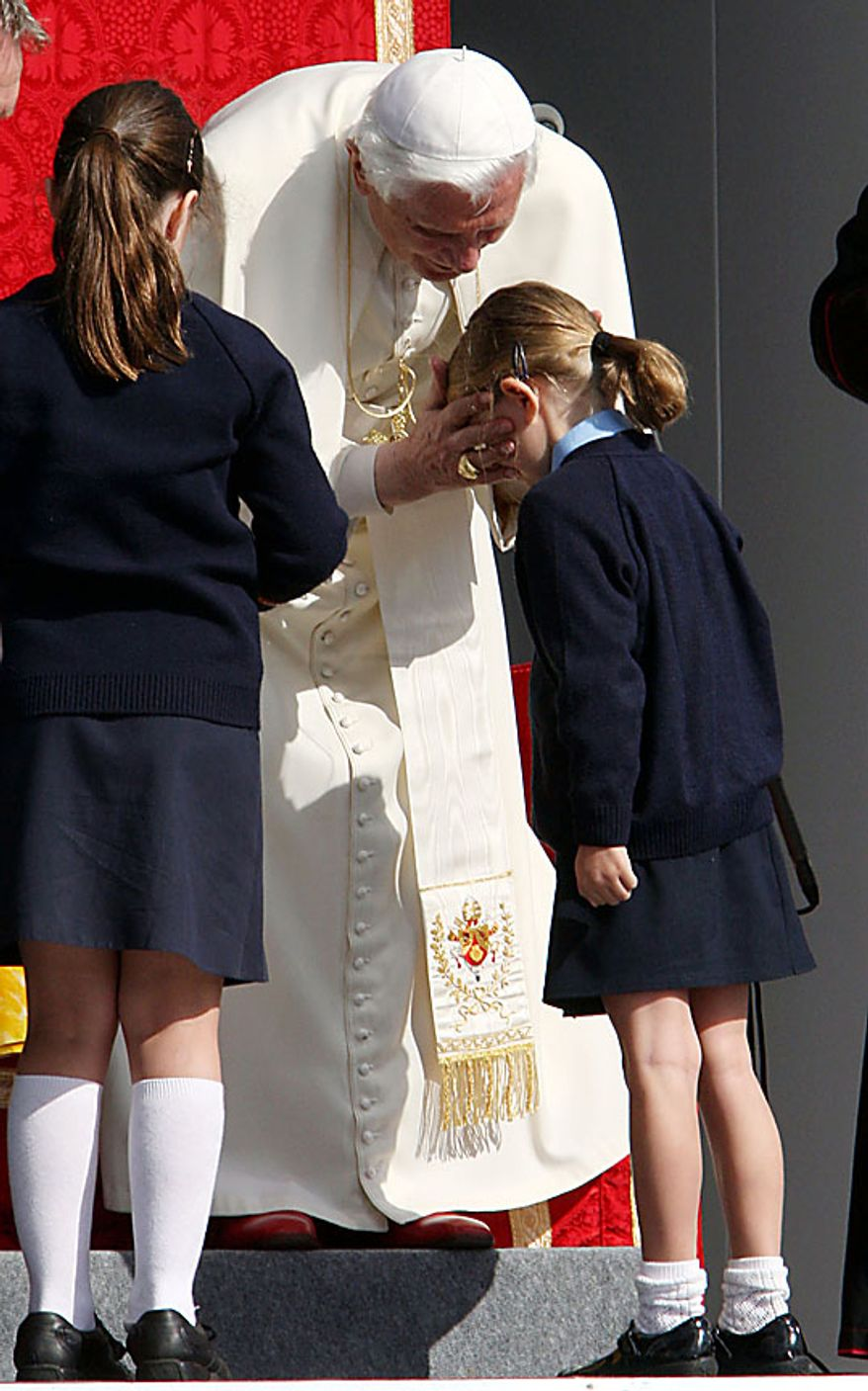 Children from the Holy Cross Primary School in Plymouth western England meet Pope Benedict XVI during a celebration of Catholic education at St Mary's University College, Twickenham, London. Friday Sept. 17, 2010. Pope Benedict XVI is on the second day of  a four-day visit, the first-ever state visit by a Pope to Britain. (AP Photo/ Steve Parsons/Pool)