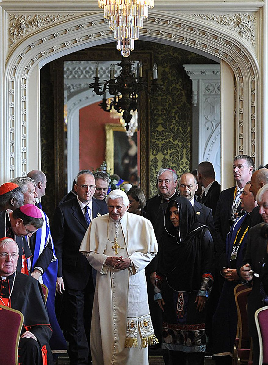 Pope Benedict XVI arrives with Britain's Baroness Warsi, centre right, at a meeting of religious leaders at St Mary's University College Chapel at Twickenham in west London, Friday, Sept. 17, 2010. The Pope is on a four-day visit to England and Scotland.(AP Photo/Toby Melville, Pool)