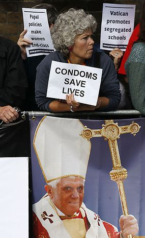Protesters hold their banners whilst demonstrating outside St Mary's University College in Twickemham, west London where Pope Benedict XVI celebrated Catholic education, Friday, Sept. 17, 2010. Pope Benedict XVI  is on a four-day visit, the first-ever state visit by a Pope to Britain. (AP Photo/Sang Tan)