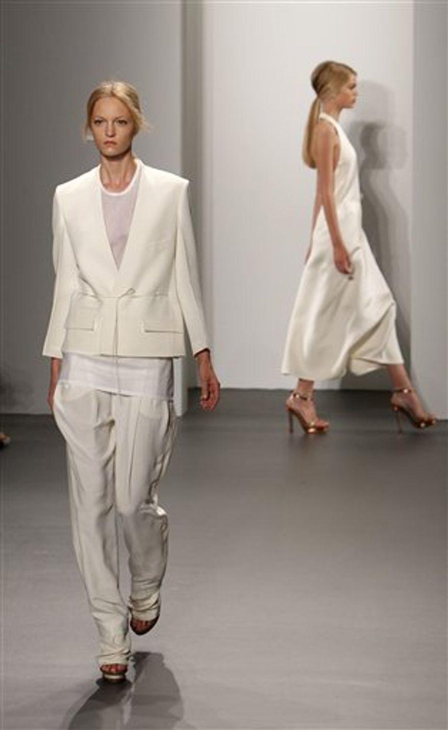 The Calvin Klein spring 2011 collection is modeled during Fashion Week in New York, Thursday, Sept. 16, 2010.  (AP Photo/Seth Wenig)