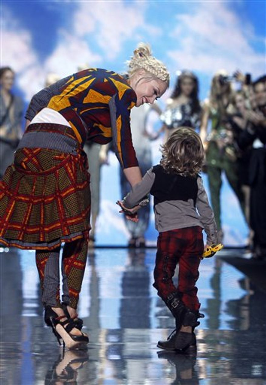 Designer Gwen Stefani acknowledges the audience after the L.A.M.B. spring 2011 collection show Thursday, Sept. 16, 2010, during Fashion Week in New York. (AP Photo/Jason DeCrow)