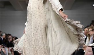 The spring 2011 collection of Ralph Lauren is modeled during Fashion Week in New York, Thursday, Sept. 16, 2010. (AP Photo/Richard Drew)