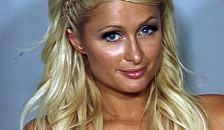 ** FILE ** This file photo released Saturday, Aug. 28, 2010, by the Las Vegas Metropolitan Police Department shows Paris Hilton in a police booking photo in Las Vegas. The district attorney in Las Vegas says Paris Hilton will avoid jail time on drug charges under the terms of a plea deal worked out with prosecutors, Friday, Sept. 17, 2010. (AP Photo/Las Vegas Metropolitan Police Department)