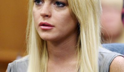 ** FILE ** In this July 20, 2010, file photo, Lindsay Lohan listens during a court hearing in Beverly Hills, Calif. (AP Photo/ Los Angeles Times, Al Seib, pool)