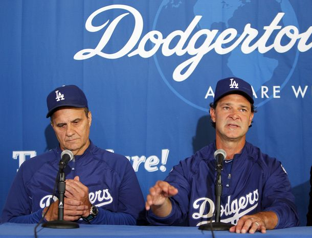Los Angeles Dodgers hitting coach Don Mattingly, right, talks with manager Joe Torre, left, at a news conference announcing Mattingly as the Dodgers manager for the 2011 season and that Torre will step aside from the position, on Friday, Sept. 17, 2010, in Los Angeles. (AP Photo/Alex Gallardo)