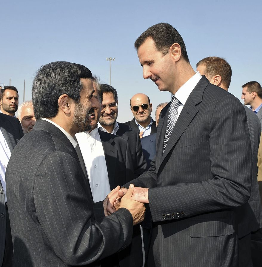 A handout picture released by the official Syrian Arab News Agency (SANA) shows Syria's President Bashar al-Assad, right, welcoming his Iranian counterpart Mahmoud Ahmadinejad at Damascus airport on Saturday, Sept. 18, 2010, at the start of the latter's three-nation trip which includes Algeria and the United States where he is to attend next week's U.N. General Assembly meeting.(AP Photo/ Sana-HO).