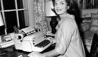 "ASSOCIATED PRESS In 1960 in her Georgetown home in Washington, Jacqueline Kennedy works on her weekly column. The newspaper column called ""Campaign Wife"" included discussion of policies and issues with personal stories and Mrs. Kennedy's advice on everyday matters such as child-rearing and shopping."