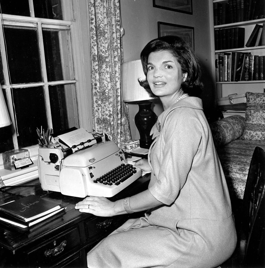 """ASSOCIATED PRESS In 1960 in her Georgetown home in Washington, Jacqueline Kennedy works on her weekly column. The newspaper column called """"Campaign Wife"""" included discussion of policies and issues with personal stories and Mrs. Kennedy's advice on everyday matters such as child-rearing and shopping."""