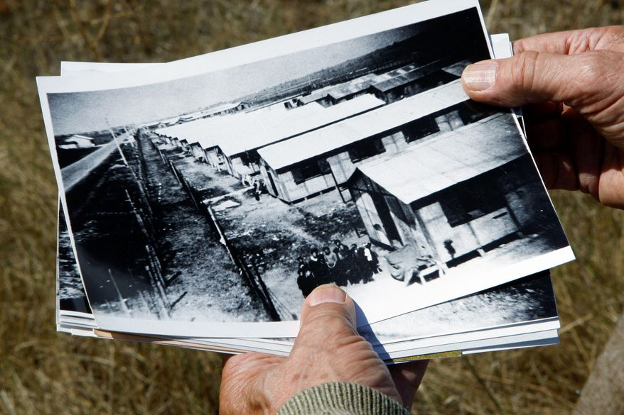 Retired schoolteacher Jacques Sigot shows photos taken of a camp in the village of Montreuil-Bellay where, during World War II, thousands of French Gypsies were interned.